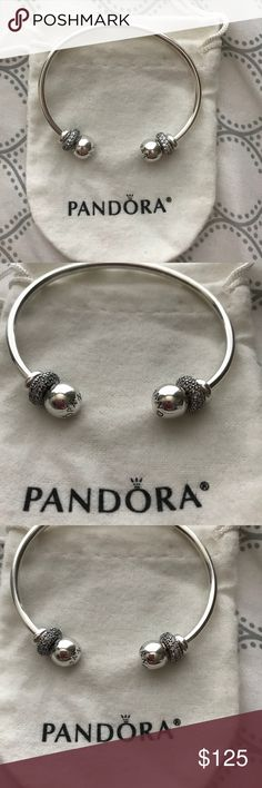 Pandora open bangle cuff + two spacers Authentic Pandora open bangle cuff plus two spacers and silicon sterling silver stoppers. Brand new with tarnish pouch. Pandora Jewelry Bracelets