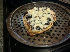 Naan pizza with eggplant paste base, chicken, olives, mozzarella cheese and feta chunks