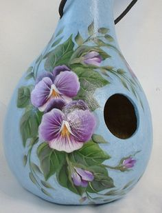 My pansie birdhouse is based in blue and white with purple flowers and buds. It is 11 tall and 17 around. Hangs from black nylon cord and has 3 Bird Houses Painted, Bird Houses Diy, Painted Birdhouses, Decorative Gourds, Hand Painted Gourds, Tole Painting, Diy Painting, Gourds Birdhouse, Gourd Art