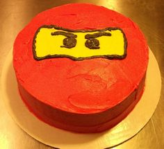 Ninjago--Do on top of Ice Cream Cake with red & yellow candies and black frosting