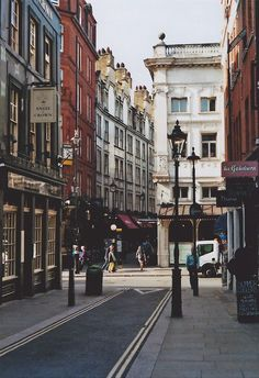 This is New Row, an enchanted place off St Martin's Lane in London. You can get to New Row via King Street from the Covent Garden piazza, after crossing Garrick. New Row ends at St Martin's as you see here; and the architecture of the old theaters in this area is fantastically fabulous.