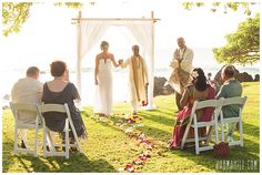 A beautiful sunset wedding at Kukahiko Estate -- a grassy oceanfront lawn surrounded by lava rocks and shaded by grand trees! They added on an arch and red and white rose petals to their Simple Maui Wedding Package. It was a wonderful time for the bride & groom and their parents!