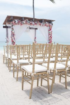 Channel the golden rays of the sun with the chairs for your ceremony here at Secrets Akumal Riviera Maya! #GoldChairs #WeddingDecor #WeddingInspo #DestinationWedding #DestinationWeddingDecor #BeachWedding
