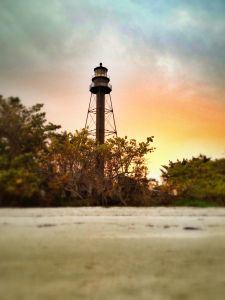 Sanibel lighthouse sunset after a storm Shot with an iphone 4s and processed with mobile snapseed.