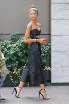 Who: Zendaya Coleman  When: August 5, 2015  Why: At the ripe age of 18, Zendaya can now add designer to her growing resume with the launch of her new shoe line, Daya. She premiered her footwear this week in a sexy jumpsuit by Solace London. The cutaway bodice and culottes silhouette are right on trend, and paired with those minimal heels that everyone in Hollywood seems to have, she's owning this look.   - ELLE.com