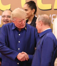 Donald Trump Photos - US President Donald Trump (L) shakes hands with Russia's President Vladimir Putin (R) as they pose for a group photo ahead of the Asia-Pacific Economic Cooperation (APEC) Summit leaders gala dinner in the central Vietnamese city of Danang on November 10, 2017..World leaders and senior business figures are gathering in the Vietnamese city of Danang this week for the annual 21-member APEC summit. / AFP PHOTO / Vietnam News Agency / STR - Asia-Pacific Economic Cooperation…