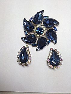 Think of the comments you'll get with this beautiful set! Blue Comma Brooch & Earring Demi Parure Item: 16854 http://www.tias.com/blue-comma-brooch--earring-demi-parure-item-16854-681532.html