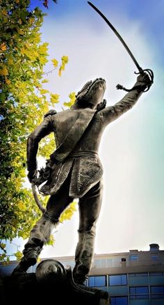 """Chapter 4: On my way home, """"standing among the new-leaved chestnut-trees in the arc-light,"""" was Ney's Statue (37). Marshal Ney, yielding his sword, looks fine in his top-boots."""