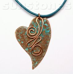 I designed this heart shape, hand cut it from annealed copper, filed the edges and hammered texture. Using on old method, I applied verdigris patina to