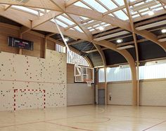 [EN] The gymnasium Regis Racine is situated in Drancy north east Paris. the program of this building includes: an indoor sports hall 22 meters long and 44 meters large, a dance hall, a space for local associations and dressing rooms for teams and...