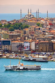Istanbul, Turkey ~ The Sultan Ahmed Mosque (Sultanahmet Camii or Blue Mosque 1609 to 1616 ) on Sarayburnu or Seraglio Point with a ferry and the banks of the Golden Horn in the foreground.  Photo: Paul Edward Williams