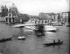 Dornier Do X, (12 engine seaplane) three only built, two bought by Italy and named Umberto Maddalena (X2) and Alessandro Guidoni (X3). This appears to be a photograph of Alessandro Guidoni moored in the Grand Canal, Venice.