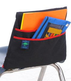 ab77e5bb43a The Aussie Pouch® Colors Chair Pocket is manufactured of sturdy black twill  fabric in six sizes and a choice of trim. The two large pockets hold books,  ...