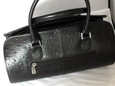 A personal favorite from my Etsy shop https://www.etsy.com/listing/256342656/leather-handbag-rare-geometric-purse