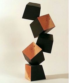 """5 Cubes, burnt and natural wood, 17"""" x 7"""" x 8""""  This was my first work in a series that explores the expressive potentials of a most rudimentary form, the cube. 4 x 4 Redwood lumber was burned and cut into blocks to reveal the woods inner warmth.  #sculpture #carving #woodcarving #chainsawcarving #lumber #deanramos #losangelesart #sandiegoart #minimalism #contemporaryart #modernart #cube #abstract #art #architecture #contemporaryartist #wood #tower"""