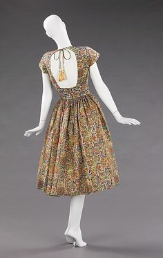 "Carolyn Schnurer (American, 1908-1998) | Dress, 1950 (Back) | Silk, custom made textile by S. Edwards | Bare-backed bodice is an adaptation of the chaniya choli worn by Kutch tribal women | ""Flight to India"" collection 