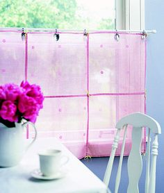 Creative Clips for Sheer Cafe Curtains... Silverware with handles bent back holds these sheer cafe curtains on a slender cafe rod. Stitch together decorative sheer napkins or squares of sheer fabric to make the curtain panels.  Look for flatware and old silverware at thrift shops and garage sales. Bend spoons and forks into U shapes. Make a small slit in the curtain to slip the spoon or fork through, and hang the bent handles over the cafe rod.