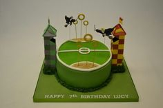 Harry Potter Quidditch Pitch Cake for boys or girls birthday. Oval shaped cake decorated to look like a quidditch pitch from the popular Harry Potter movies. Two towers and a cutout of Harry Potter and Ron Weasley flying on wires. Harry Potter Quidditch, Quidditch Pitch, Harry Potter Fiesta, Harry Potter Torte, Harry Potter Birthday Cake, Harry Potter Bday, Harry Potter Food, Harry Potter Halloween, Happy 7th Birthday