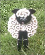macaroni sheep. These are really cute only we used paper reinforcers instead of macaroni