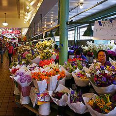 Bright blooms are a specialty of Seattle's farmers markets, but the Hmong farmers cultivating that niche market are losing their livelihood to an increasingly erratic Snoqualmie River