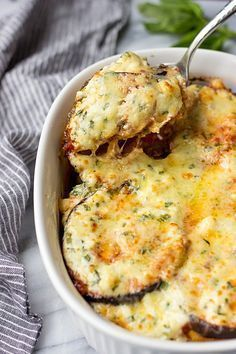 Eggplant Gratin with Feta Cheese is so GOOD! Tender eggplant is layered with a tomato sauce, Gruyere and drizzled with a creamy Feta sauce. Baked until bubbly PERFECTION. This is one of the BEST Eggplant Recipes and is a great Thanksgiving recipe. #ThanksgivingRecipes #thanksgivingsides #christmasrecipes