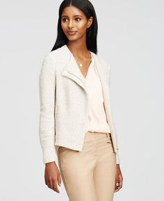 "All you need is tweed this season, especially when tailored in a modern moto-inspired silhouette. Jewel neck. Long sleeves. Asymmetrical zip front. Vertical exposed zip pockets. 20 1/2"" long."