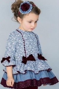 A stunning dress by Dolce Petit, it has length sleeves which flare at the cuffs, the dress has a vintage patttern with large bows on the front, it is finished off with layers and lace around the bottom Baby Girl Fashion, Toddler Fashion, Kids Fashion, Little Dresses, Little Girl Dresses, Girls Dresses, Toddler Dress, Baby Dress, Baby Frocks Designs