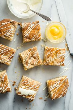 Moist lemon coffee cake with white chocolate chips and extra chocolate drizzled on the crunchy sugar topping. This is the best coffee cake ever, no joke!