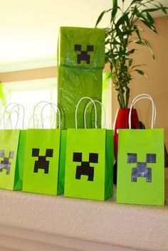 These were all my Minecraft party decorations! The Creeper thank you bags and the pinata in the background