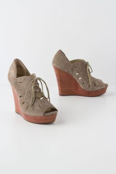 """- Fits true to size - Tie closure - Leather upper - Synthetic insole, sole - 4.5"""" synthetic wedge; 1"""" platform - Imported"""
