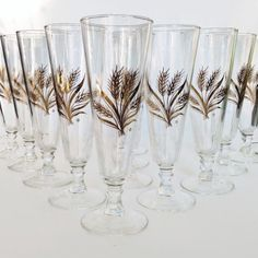 Mid century Pilsner beer glasses Clear glass with a gold wheat design Set of 12 8 1/4 inches tall with a 3 inch diameter Excellent vintage