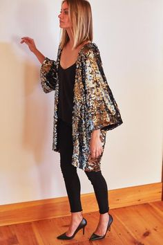 Without a doubt, an EF staff favorite. A sequin Kimono sleeve jacket in beautiful gunmetal tones. Ships well in time for your holiday festivities. Anytime you put this on, even just around the house,