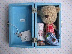 Molly Chicken's cute bear in a box.