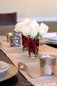 Easy table decor. Cranberries and roses... classic red and white.