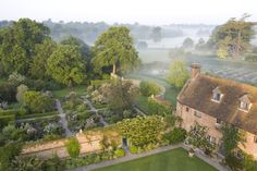 """english-idylls: """" Early morning misty view of the Rose Garden, seen from the Tower at Sissinghurst Castle Garden, near Cranbrook, Kent. """""""