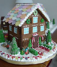 Necco Wafers on the roof, 4 chocolates stacked for door, & candy canes framing it