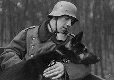 A German soldier with a German Shepherd