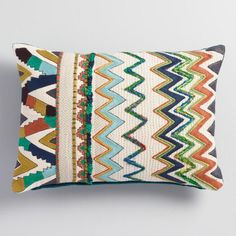 An understated neutral palette meets a lively zigzag pattern in our textural lumbar pillow, a bold but versatile addition to any space.