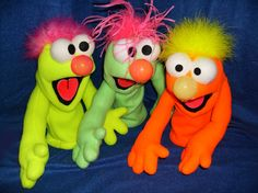 Silly little fleece puppets that make great back-up singers 10″ available in green/pink/orange/yellow blacklight with an ostrich tuft or marabou hair