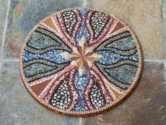 Art. Handmade decorative wall hanging. Design made of crushed sea shells