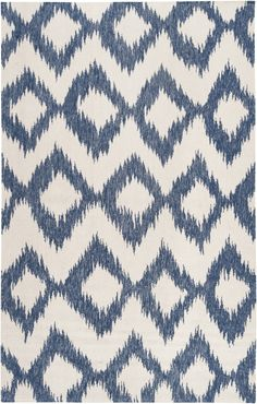 Cool diamond shaped inkblots make for a creative pattern on this chic, modernistic rug; a great match for a cosmopolitan space.