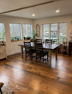 This Shaker-style farm table was handcrafted using reclaimed barn wood. Cherry wood was used to craft the Manhattan ladder back side chairs. The random-width wide plank flooring is reclaimed yellow pine. For custom furniture for all rooms of the home, hardwood flooring, reclaimed flooring and custom kitchens, visit www.braunfarmtables.com
