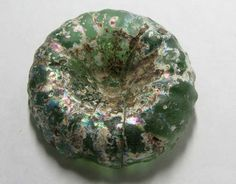 This is a parcel of stunning glass beads specimen which is between 700 to 3000 years old.Thousands of years ago, the Romans came to Afghanistan to trade glass and teach the art of glass making. Buried for centuries, the discarded chunks had been thrown into a pit for recycling, a common practice in ancient times, but instead were forgotten.It was just recently re found.These pieces we selected for their stunning colour-ideal as a centre piece in a necklace or kept a as a specimen.It should…