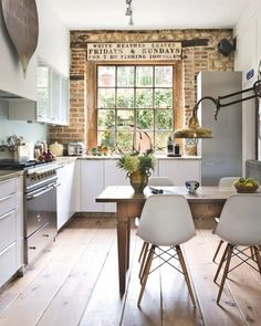Vintage modern farmhouse kitchen design in a small, narrow space featuring an ex. Vintage modern farmhouse kitchen design in a small, narrow space featuring an exposed brick wall, track lighting, large . Kitchen Interior, New Kitchen, Kitchen Decor, Cozy Kitchen, Kitchen Ideas, Rustic Kitchen, Country Kitchen, Kitchen Industrial, Kitchen Dining