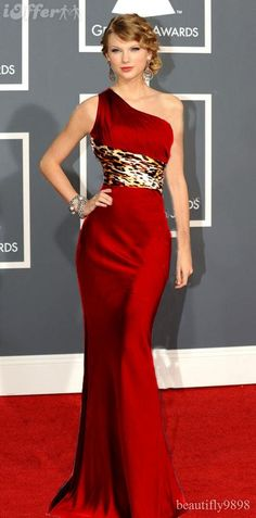 I didn't know it was possible to make leopard print and red satin look classy. Well-done, Taylor Swift.