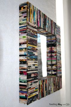 Top 10 DIY Mirror Frames - could do this with cassette tapes or dvd's,or books!