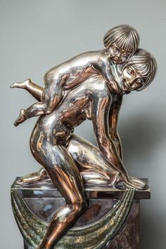 "Abel R. Philippe created ""Mother playing with her Child,"" an Art Deco silvered bronze group sculpture, in the 1930s."