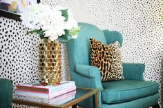Thibaut Tanzania Wallpaper with Green Wingback Chairs.