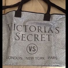 BNWOT VS OVERNIGHTER BAG $40 BNWOT- in on-line packaging VICTORIA SECRET OVERNIGHTER BAG sparkling canvas zip top 2 handles with an over the shoulder strap says VICTORIA SECRETS VS LONDON NEW YORK PARIS on the front NO TRADES NO OTHER Apps will price drop Victoria's Secret Bags