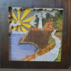 A lighthouse themed wood piece I made for a friend. Based on a famous painting. #wood #woodworking #art #wallart #lighthouse #sunrise #stain this piece is 2'x2'